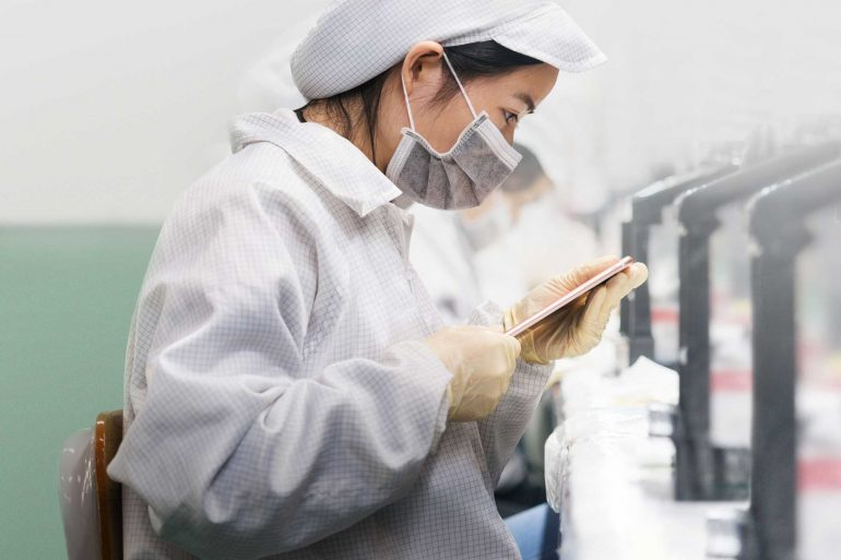 Worker Inspecting iPhone