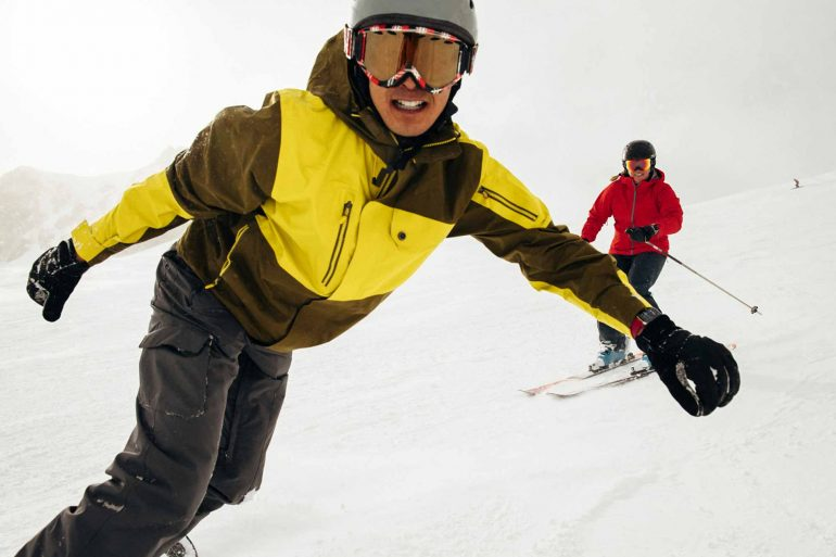 Man Snowboarding with Apple Watch-with Girl Skiing on Mountain NZ
